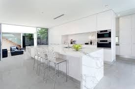 calacatta marble kitchen waterfall: neolith classtone series neolith polished calacatta island counter top waterfall