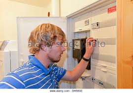 fuse boxes stock photos fuse boxes stock images alamy young man turning off a fuse in a fuse box stock image