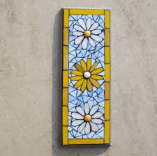 designs outdoor wall art: simple mosaic flower pattern wall plaque with white and yellow david l gray has  subscribed exterior