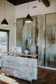 iron wall decor u love: barn door reception desk made with reclaimed wood and metal wall i think you need to face your reception desk with something cool like this i also love