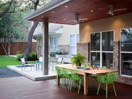 garden furniture patio uamp: casual dining under a tigerwood ceiling on an ipe deck adjacent to a light limestone patio