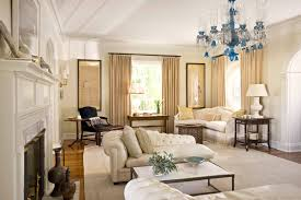 cream couch living room ideas: interior glamorous japanese living room ideas with chandelier and sectional sofa with pillows and bay window