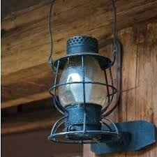 the secret to lighting a log cabin country retreat lake house or lodge is cabin lighting ideas