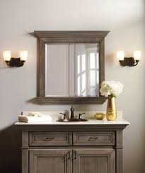 with cabinet mouldings that allow the light to play over fine cabinet stains and rich glazes bathroom vanity barnwood mirror oyster pendant lights