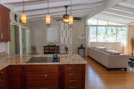 kitchen design entertaining includes: entertaining groups is easy and comfortable in this home this home is modernized yet retains its charming mid century feel and some of its