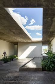 cc arquitectos links agricultural offices in mexico with water filled patios agri office mezzanine