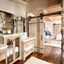 sliding bathroom mirror: a charming bathroom with wooden flooring and sliding door also rustic cabinet and frameless mirror