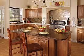 countertops popular options today: cortina granite countertops paired with bronzite glass mosaic tile backsplash