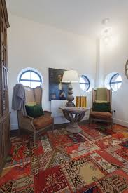 kennington water tower example of an eclectic home office design in london with white walls carpet oval office inspirational
