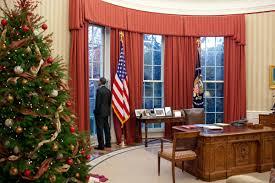 oval office barack obama enters oval