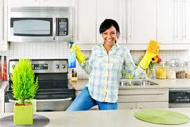 clean kitchen: refresh your cluttered kitchen woman cleaning kitchen horiz nrzwt refresh your cluttered kitchen