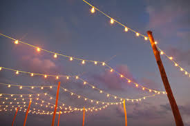 simple bistro lights on tall wooden poles are for sure my favorite but ive just got to figure out how to get those pole either in the ground or maybe in backyard party lighting