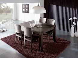 wood extendable dining table walnut modern tables: lavish expandable dining tables with white pendant lighting and red rug also wooden dining chairs for