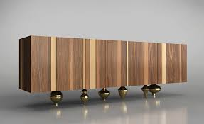 il pezzo 1 is a modern sideboard that combines solid wood with rounded sand cast brass feet brass furniture