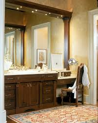 double sink vanity with makeup area bathroom traditional with apothecary jars baseboard makeup bathroom makeup lighting