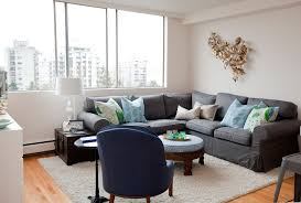 west end studio inspiration for an eclectic living room remodel in vancouver with white walls charming eclectic living room ideas