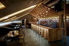 ravishing attic bar blends rustic textures with contemporary design attic lighting ideas