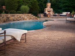 gallery outdoor living wall featuring:  ci belgard hardscapes outdoor fireplace pool sxjpgrendhgtvcom