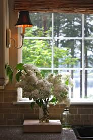 sink windows window love: sconce lighting to flank kitchen sink window nice way to bring