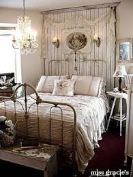 this is an example of a romantic shabby chic style bedroom with the chandelier and bedroom ideas shabby chic