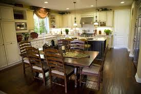 countertops dark wood kitchen islands table: this large open kitchen contrasts rich dark wood flooring and dining set with light