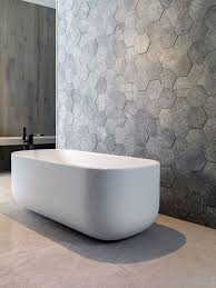 stick wall tiles quotxquot: bathroom tile ideas grey hexagon tiles these grey hexagonal wall tiles stick out slightly from the wall to create a textured honeycomb look