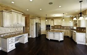 beautiful white kitchen cabinets: massive white kitchen with distressed wood and granite island