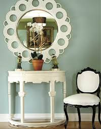 foyer with green walls mirror chair and console table added drama mirrored bedroom furniture
