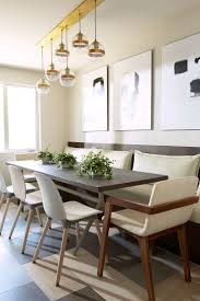 dining room khaki tone: built in banquette in neutral gray tones slim rectangular table brass light fixture  tone mixed tile floor in this eat in dining room space