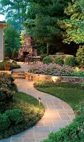 lighting in garden. outdoor fireplace tiered landscaping and curved path the raw copper lights that will patina over time look great unique for years to come lighting in garden a
