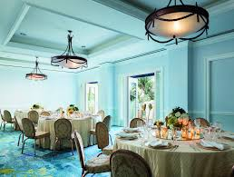 french decor la round dining tables with formal daccor in a room with open french door