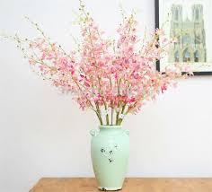 Resultado de imagem para flor cattleya arranjos