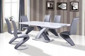extendable dining table set: kitchenmodern dining room with cozy black chair and cool white table on white fur