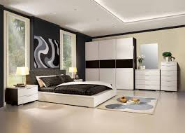 colours for a bedroom: cream black wall room combined cream black wall room combined with high glass windows combined with low profile white wooden bed also black white bedding set completed with large white black wardrobe