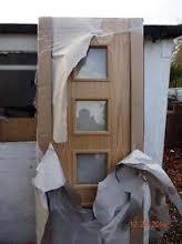 2 new packaged veneer oak doors cost over 300 each bargain 100 for both camberley oak 2 door