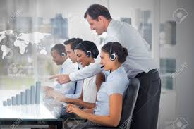Call Center Employees At Work On Futuristic Interfaces Showing ... Stock Photo - Call center employees at work on futuristic interfaces showing map and graph with supervisor in the office
