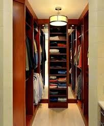 closet breathtaking small walk in closet designs pictures made by wooden also charming wooden cabinets with huge pendant lights also laminate floor and best closet lighting