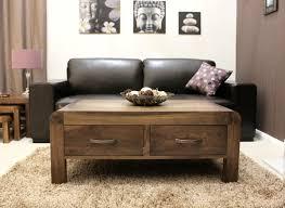 solid walnut hidden home office shiro shiro walnut four drawer coffee table add wishlist middot baumhaus mobel