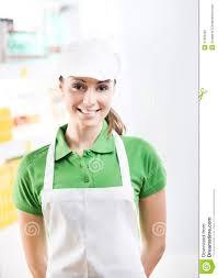 female s clerk working at supermarket stock photo image female s clerk working at supermarket