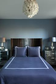bedroom design idea: small blue bedroom with curved headboard