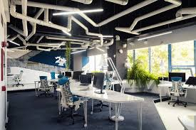 office room with blue colored soft chairs and blue floor which is covered with rug carpet blue office room design