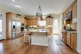 kitchen design entertaining includes: just beyond the kitchen is a back hall that includes extended counter space extra storage and a wine cooler