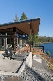 ideas about Modern Lake House on Pinterest   Lake Houses    Swooning over Uptic Studio    s Modern Cabins and Woodsy Homes Hammer  This deck    Modern lake house