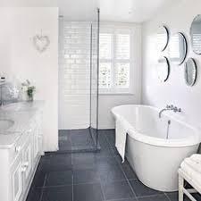 white bathroom floor: a combination of dark grey floor tiles and white walls creates a soft monochrome