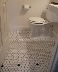 traditional style antique white bathroom: vintage style powder room white mosaic floor tiles traditional bathroom