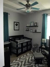 grey chevron and teal or turquoise boys nursery or room with black furniture painted black furniture