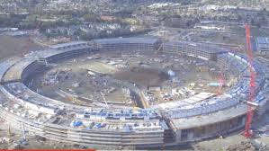 apple is busy creating a vast new campus headquarters shaped like a ring and looking like its liable to take off hover over cupertino and head to the apple new office