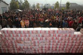 chinese farmers build million wall of money the times cash crop villagers examine their money wall built cash from year