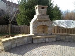 outdoor fireplace paver patio: paver patio with outdoor fireplace and seating wall
