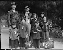 dorothea lange s censored photographs of fdr s ese 8 1942 hayward california members of the mochida family awaiting evacuation